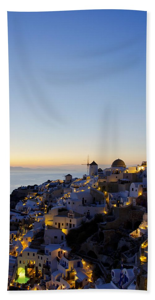 Island Beach Towel featuring the photograph Oia At Dusk by Jack Daulton