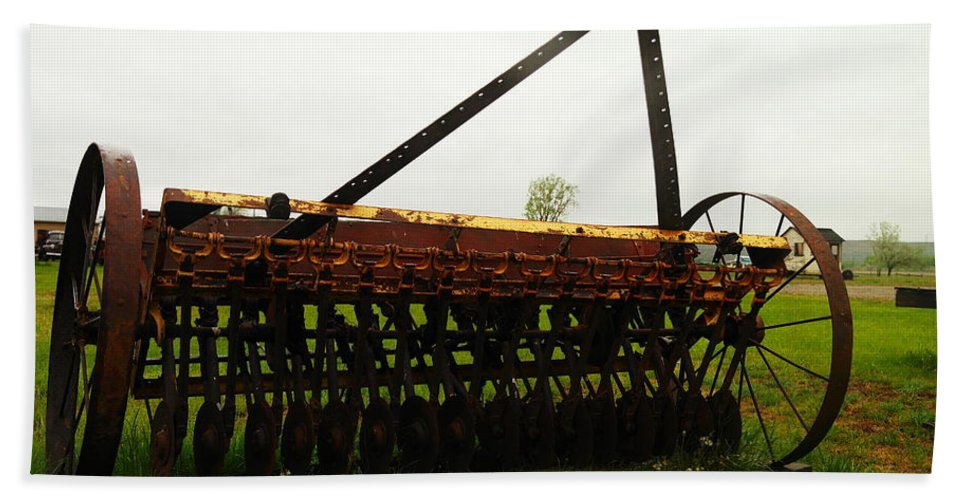 Antiques Beach Towel featuring the photograph Old Farm Equipment by Jeff Swan