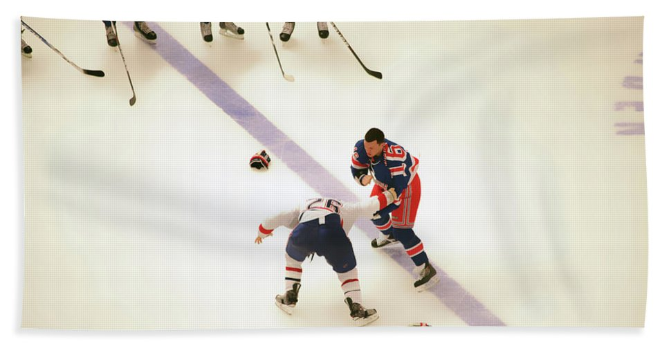 Hockey Beach Towel featuring the photograph One Two Punch by Karol Livote