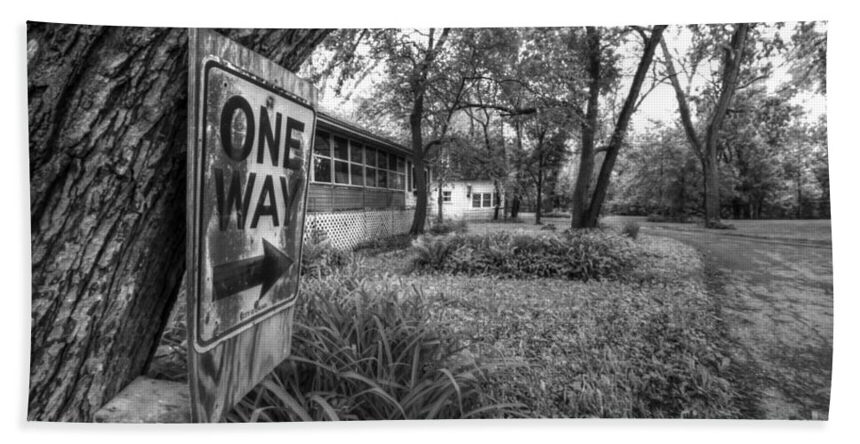 Sign; Signage; Tree; Posted; Post; Plants; Road; Street; Town; Neighborhood; Trees; Houses; Homes; Pavement; Grass; Yard; Curve; Bend; One Way; One; Arrow; Law; Black; White; Monochrome Beach Towel featuring the photograph One Way by Margie Hurwich