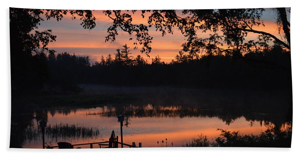 Sunrise Beach Towel featuring the photograph Orange Blue And Black by Thomas Phillips