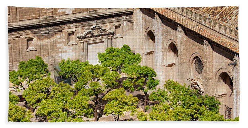 Garden Beach Towel featuring the photograph Patio De Los Naranjos Of Seville Cathedral by Artur Bogacki
