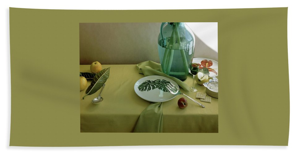 Table Setting Beach Towel featuring the photograph Plates, Apples And A Vase On A Green Tablecloth by Horst P. Horst