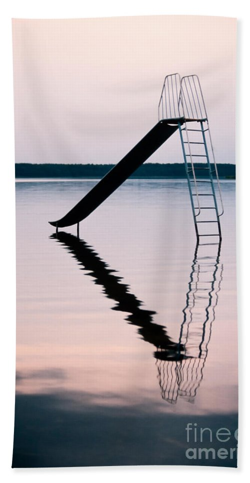 Aquatics Beach Towel featuring the photograph Playground Slide In Lake by Stephan Pietzko