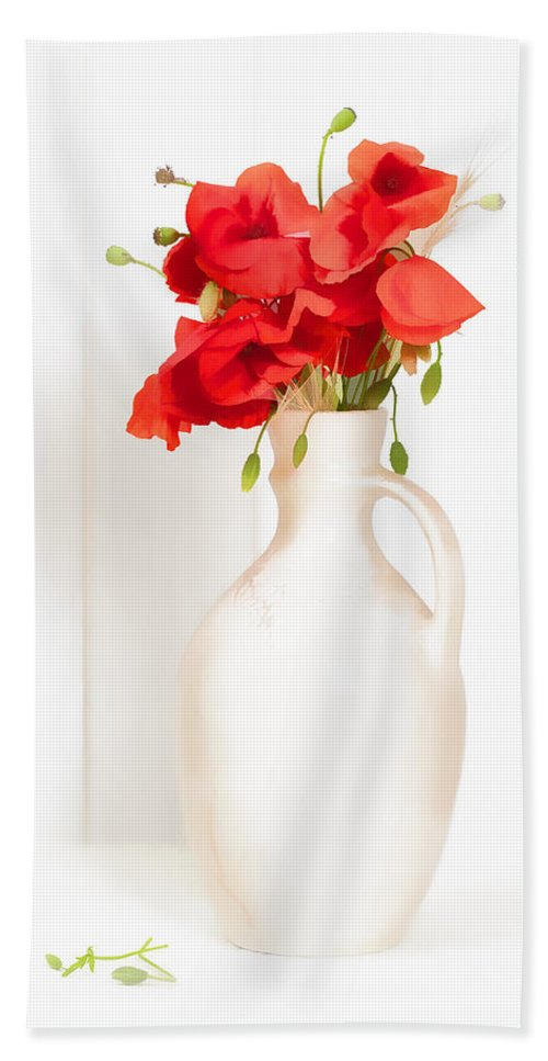 Poppy; Poppies; Bright; Red; Vase; Antique; Jug; Table; White; Background; Flowers; Floral; Display; Rustic; Stems; Seedheads; Buds; Green; Spring; Summer; Wild; Flower; Petals Beach Towel featuring the photograph Poppies by Amanda Elwell