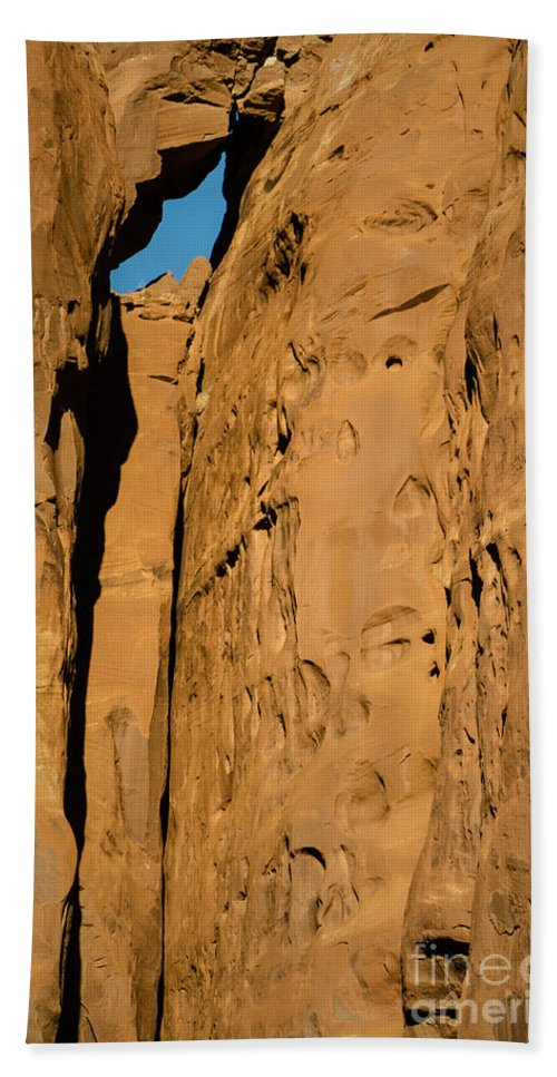 Stone Beach Towel featuring the photograph Portal Through Stone by Jeffrey Kolker