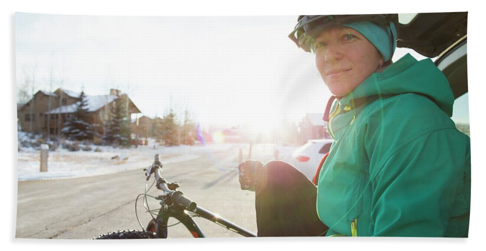 Cold Temperature Beach Towel featuring the photograph Portrait Of A Woman After A Winter Ride by Mike Schirf
