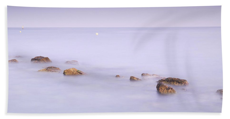 Water Beach Towel featuring the photograph Purple Seascape by Guido Montanes Castillo