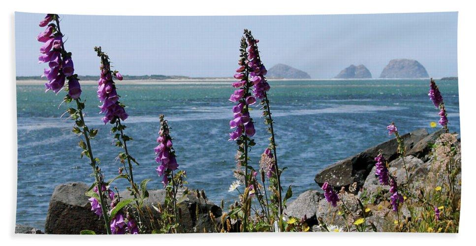 Netarts Bay In Oregon Beach Towel featuring the photograph Purple Wildflowers At Netarts Bay by Athena Mckinzie