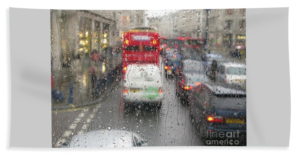 Rainy Day London Traffic By Ann Horn Beach Towel featuring the photograph Rainy Day London Traffic by Ann Horn