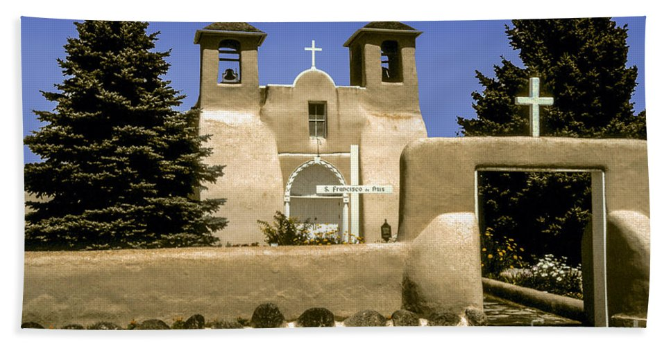 Ranchos De Taos New Mexico San Francisco De Asis Mission Church Churches Places Of Worship Cross Crosses Tree Trees Building Buildings Structure Structures Architecture City Cities Cityscape Cityscapes Beach Towel featuring the photograph Ranchos De Taos Church by Bob Phillips