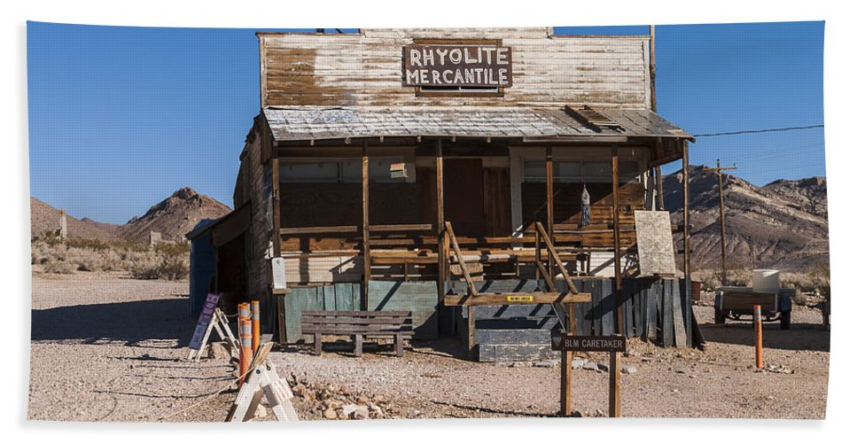 Death Valley Beach Towel featuring the photograph Rhyolite Mercantile by Muhie Kanawati