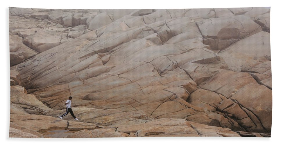 Peggy's Cove Beach Towel featuring the photograph Rock Jogger At Peggy's Cove by Kyra Savolainen
