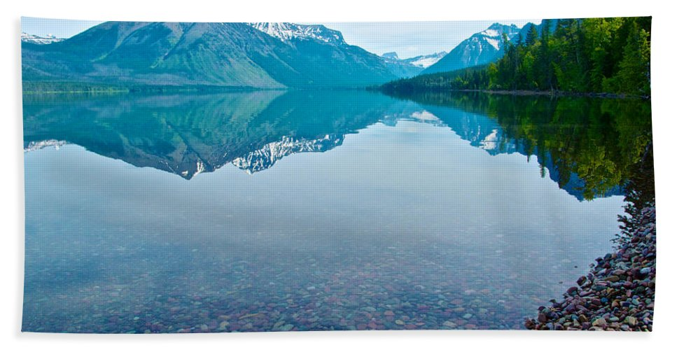 Rocky Mountain Beach Towel featuring the photograph Rocky Mountain And Rocky Bottom Reflection In Lake Mcdonald In Glacier National Park-montana by Ruth Hager