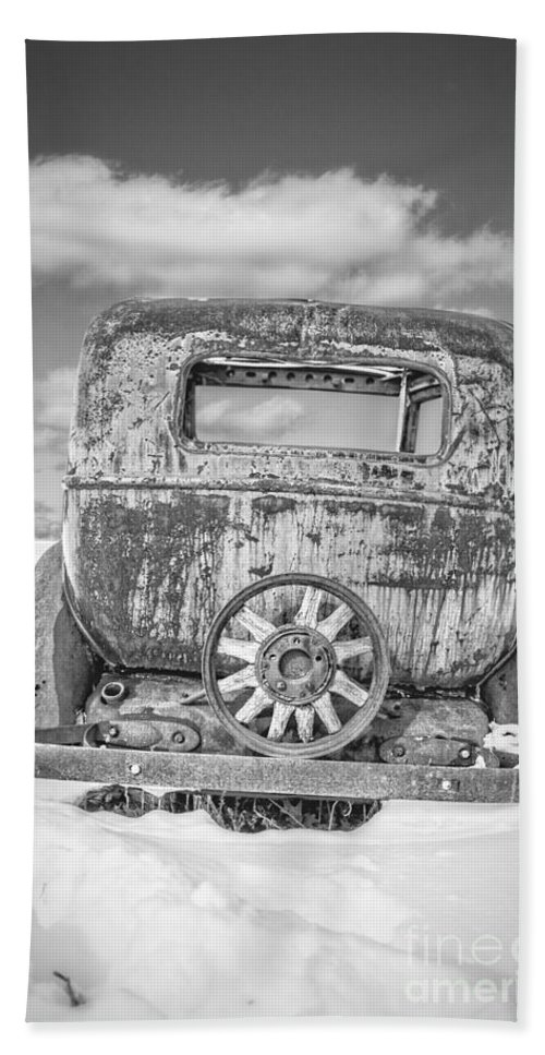 Winter Beach Towel featuring the photograph Rusty Old Car In The Snow by Edward Fielding
