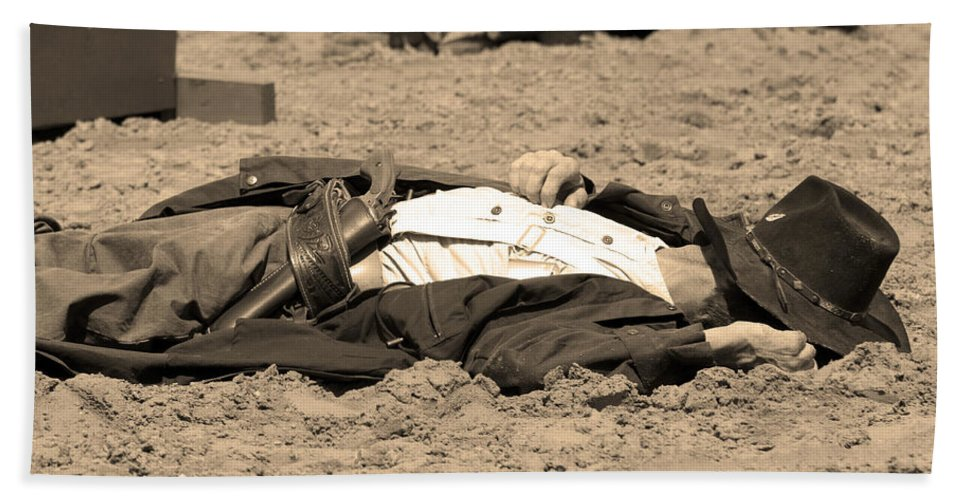 Sepia Beach Towel featuring the photograph Sepia Rodeo Gunslinger Victim by Sally Rockefeller