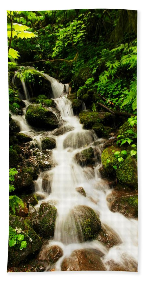 Rivers Beach Towel featuring the photograph Sliding Over The Rocks by Jeff Swan