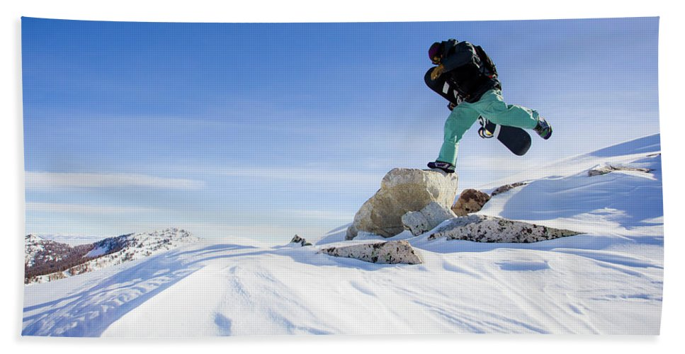 Cold Temperature Beach Towel featuring the photograph Snowboarder Jumping by Ben Girardi