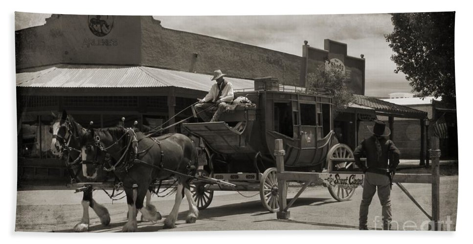 Gunslingers Beach Towel featuring the photograph Stage Coming Through Tombstone by John Malone