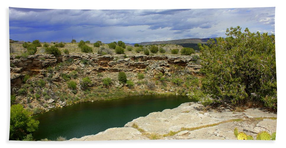 Verde Valley Beach Towel featuring the photograph Storm Clouds Over Montezuma Well by Carol Groenen