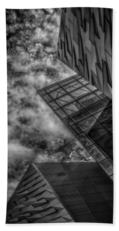Bw Beach Towel featuring the photograph Stormy Clouds Over Modern Building by Gareth Burge Photography