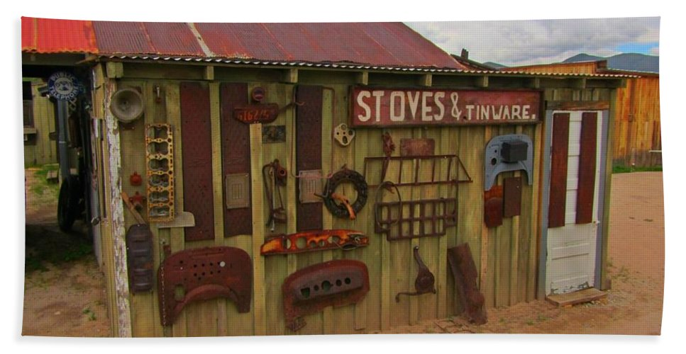 Stoves And Tinware Beach Towel featuring the photograph Stoves And Tinware by John Malone