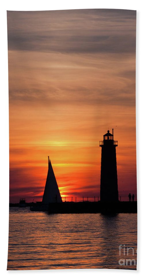 Sailboat Beach Towel featuring the photograph Sun Set At The Muskegon Lighthouse by John Harmon