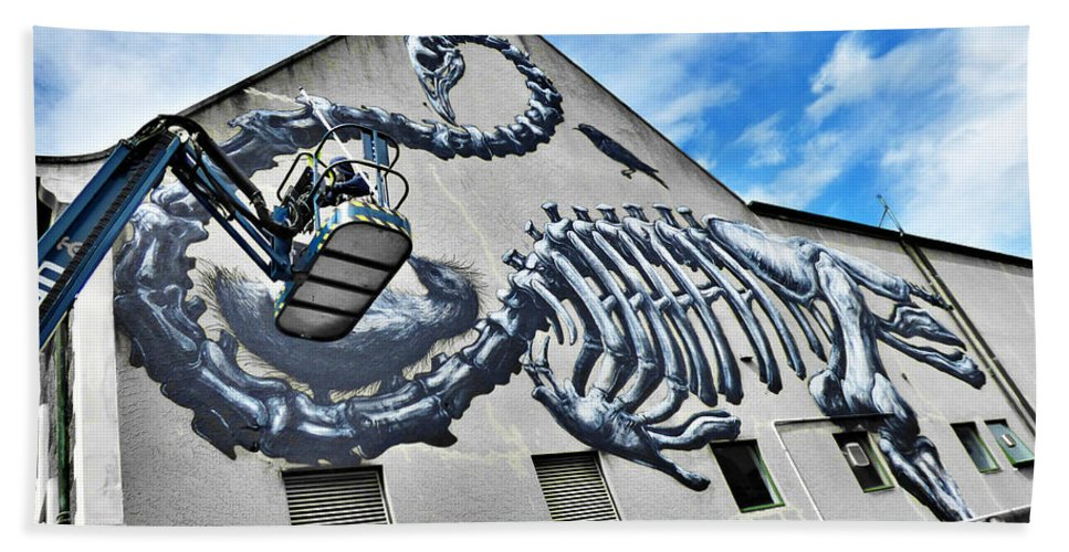 Roa Beach Towel featuring the photograph The Artist Roa At Work by Steve Taylor