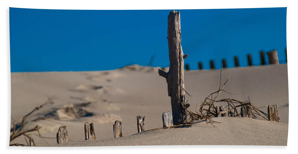 Sand Beach Towel featuring the photograph The Lonely Driftwood by Trish Tritz