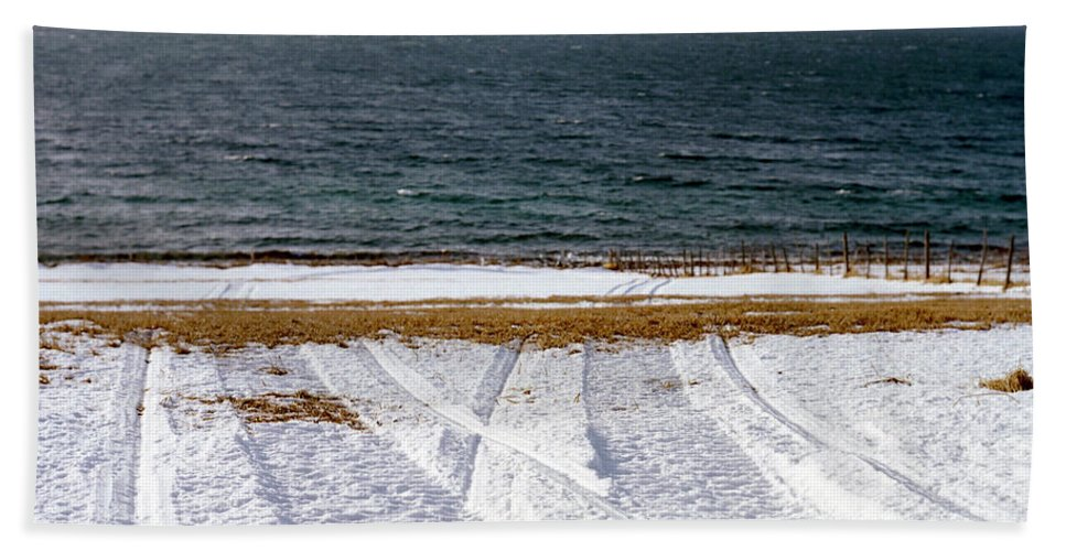 Coast Beach Towel featuring the photograph The Lyngen Alps And Snowmobile Tracks by Kari Medig