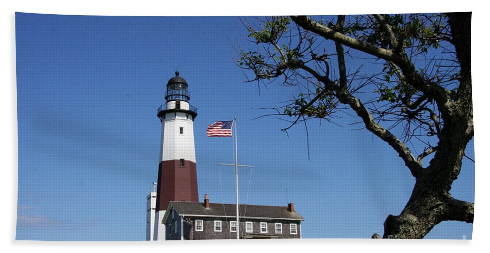 Montauk Point Lighthouse Beach Towel featuring the photograph The Montauk Point Lighthouse by Christiane Schulze Art And Photography