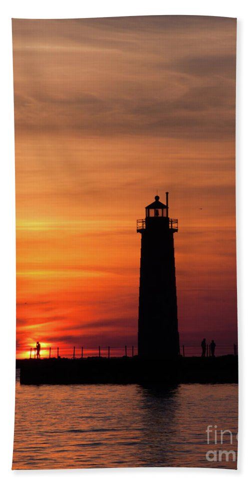 Nautical Beach Towel featuring the photograph The Muskegon Lighthouse An A Lone Man Fishing by John Harmon
