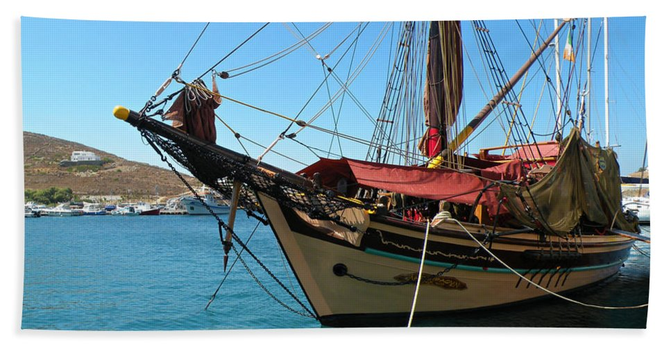 Ios Beach Towel featuring the photograph The Pirate Ship by Micki Findlay