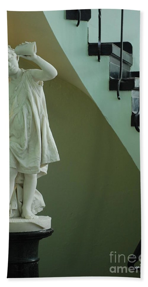 The Statue Beach Towel featuring the photograph The Statue In The Stairway by Robert Meanor
