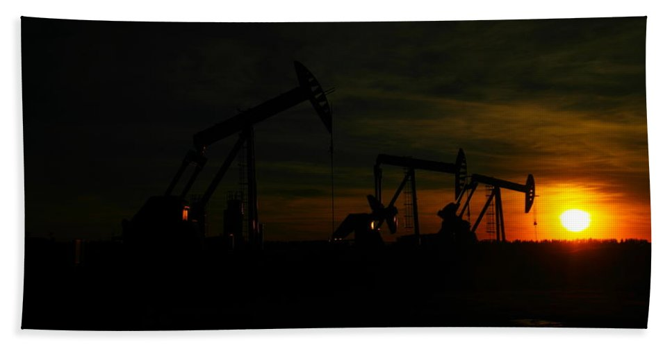 Oil Beach Towel featuring the photograph Three Pump Jacks At Dusk by Jeff Swan