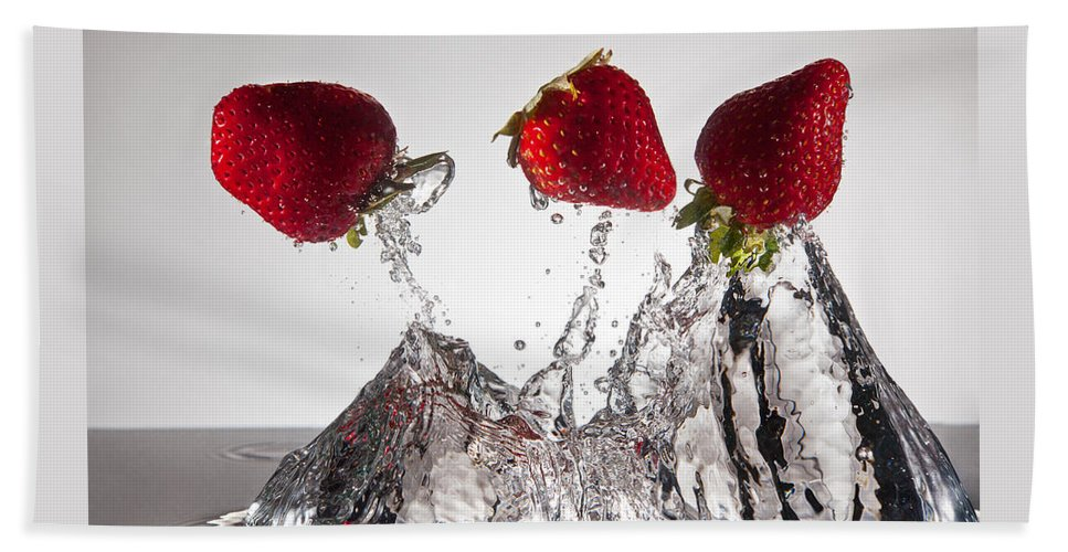 Water Beach Towel featuring the photograph Three Strawberries Freshsplash by Steve Gadomski