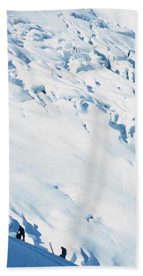 Adventure Beach Towel featuring the photograph Two Mountaineers High On The Slopes by Heath Korvola