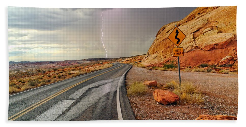 Lightning Beach Towel featuring the photograph Uncertainty - Lightning Striking During A Storm In The Valley Of Fire State Park In Nevada. by Jamie Pham