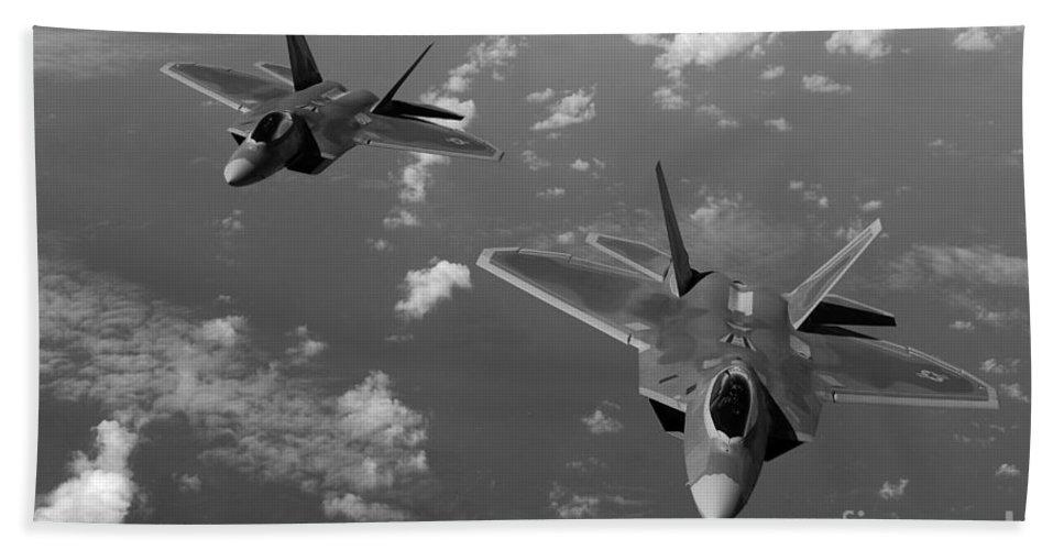 Guam Beach Towel featuring the photograph U.s. Air Force F-22 Raptors In Flight Near Guam. by Stocktrek Images