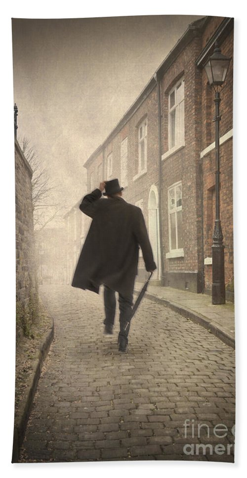Victorian Beach Towel featuring the photograph Victorian Man Running On A Cobbled Road by Lee Avison