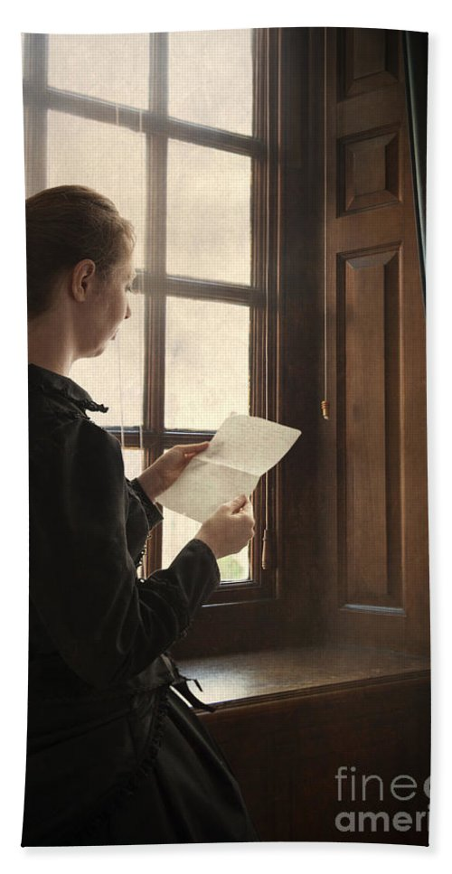Woman Beach Towel featuring the photograph Victorian Or Edwardian Woman Reading A Letter By The Window by Lee Avison