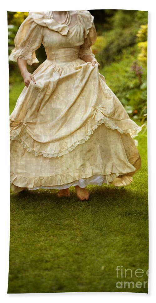 Woman Beach Towel featuring the photograph Victorian Woman Running On A Summer Lawn by Lee Avison