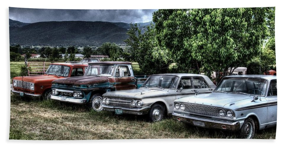 Colorado Beach Towel featuring the Well Used Cars For Sale by Bob Hislop