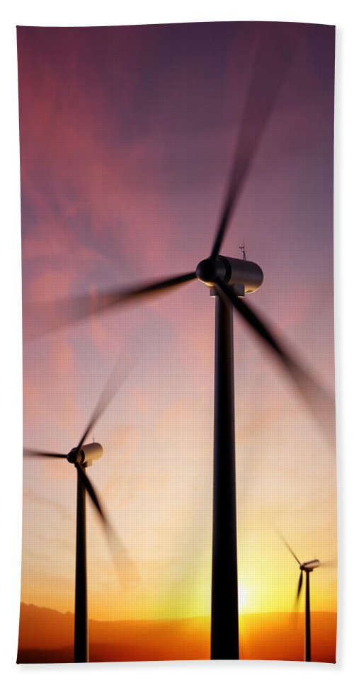 Wind Beach Towel featuring the photograph Wind Turbine Blades Spinning At Sunset by Johan Swanepoel
