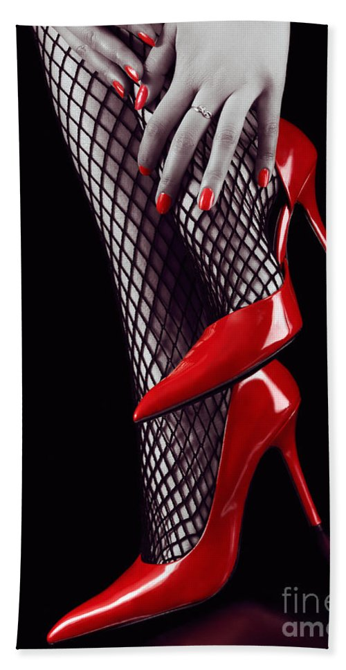 Woman legs in sexy red high heels and