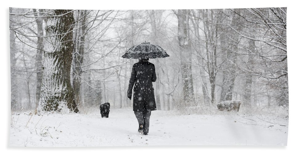 Path Beach Towel featuring the photograph Woman Walking In A Snowy Forest by Mats Silvan