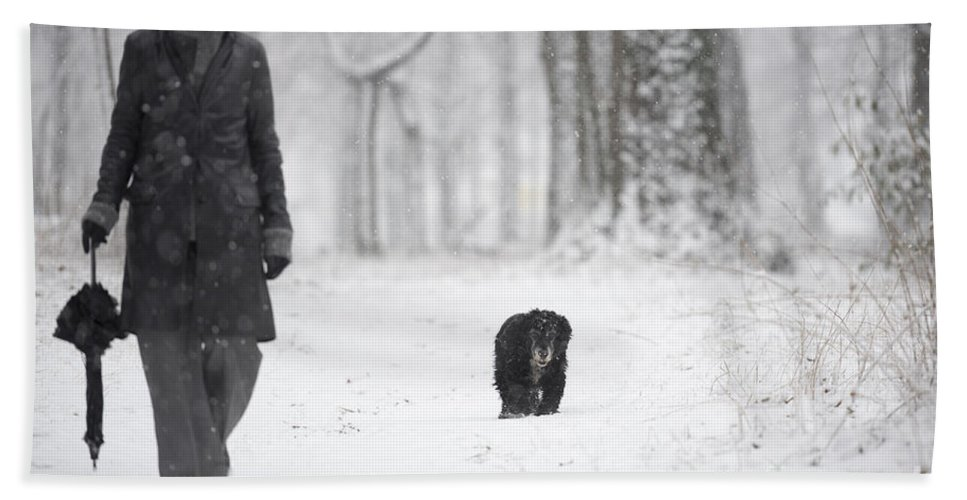 Path Beach Towel featuring the photograph Woman Walking In The Snowy Forest by Mats Silvan