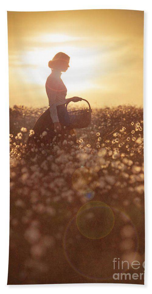 Edwardian Beach Towel featuring the photograph Woman With A Wicker Basket At Sunset by Lee Avison