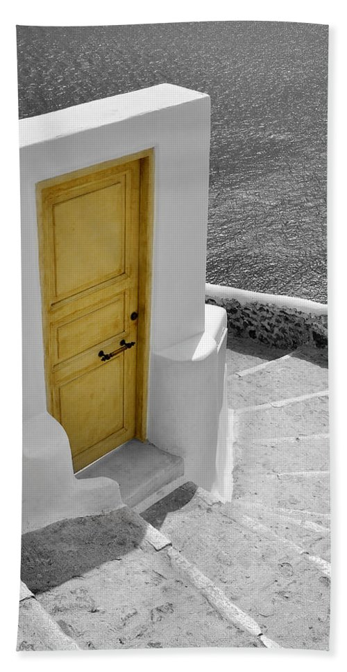 Island Beach Towel featuring the photograph Yellow Door Of Oia by Jack Daulton