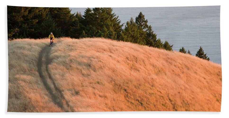 25-35 Beach Towel featuring the photograph Young Man Biking Near Bolinas Ridge Mt by Justin Bailie